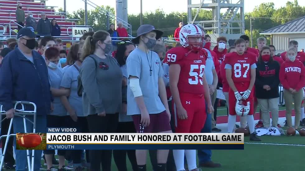 Jacob Bush and family honored at football game
